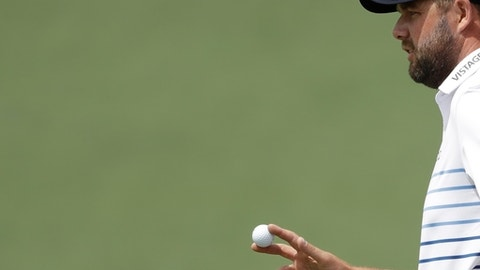 Marc Leishman, of Australia, reacts after his putt on the second hole during the second round at the Masters golf tournament Friday, April 6, 2018, in Augusta, Ga. (AP Photo/Matt Slocum)
