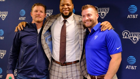 Los Angeles Rams new defensive tackle Ndamukong Suh, center, poses for a photo after a news conference with head coach Sean McVay, right, and general manager Les Snead, left, at the team's practice facility in Thousand Oaks, Calif., Friday, April 6, 2018. (AP Photo/Richard Vogel)