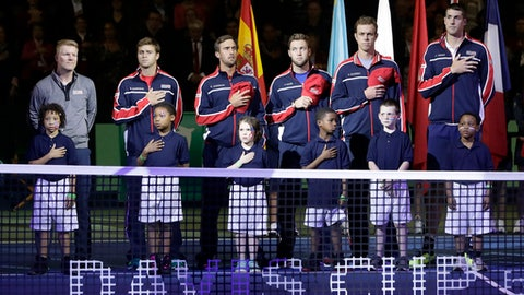 The United States team stands for the national anthem before a Davis Cup quarterfinal singles tennis match against Belgium Friday, April 6, 2018, in Nashville, Tenn. (AP Photo/Mark Humphrey)