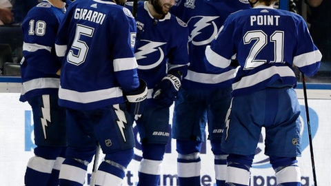 Tampa Bay Lightning defenseman Dan Girardi, second from left, celebrates with teammates, from left to right, Ondrej Palat, Nikita Kucherov, Victor Hedman, and Brayden Point after scoring against the Buffalo Sabres during the second period of an NHL hockey game Friday, April 6, 2018, in Tampa, Fla. (AP Photo/Chris O'Meara)