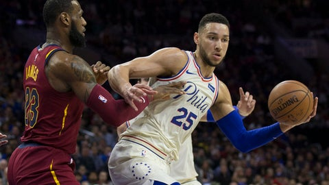 PHILADELPHIA, PA - APRIL 6: Ben Simmons #25 of the Philadelphia 76ers controls the ball against LeBron James #23 of the Cleveland Cavaliers in the first quarter at the Wells Fargo Center on April 6, 2018 in Philadelphia, Pennsylvania. (Photo by Mitchell Leff/Getty Images)