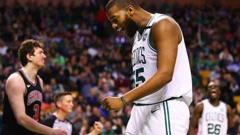 BOSTON, MA - APRIL 6:  Greg Monroe #55 of the Boston Celtics reacts after being fouled by Omer Asik #3 of the Chicago Bulls during a game at TD Garden on April 6, 2018 in Boston, Massachusetts. (Photo by Adam Glanzman/Getty Images)