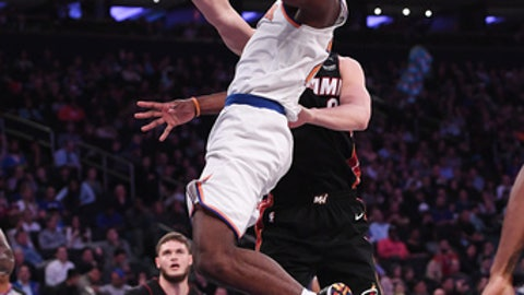NEW YORK, NY - APRIL 6: Damyean Dotson #21 of the New York Knicks lays up a shot against Kelly Olynyk #9 of the Miami Heat during the game at Madison Square Garden on April 6, 2018 in New York City. (Photo by Matteo Marchi/Getty Images)