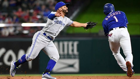 Toronto Blue Jays second baseman Devon Travis fails to apply the tag on Texas Rangers' Elvis Andrus (1) on a ground out by Adrian Beltre during the fifth inning of a baseball game Friday, April 6, 2018, in Arlington, Texas. (AP Photo/Jeffrey McWhorter)