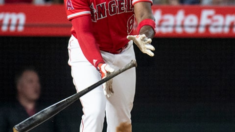 Los Angeles Angels' Justin Upton watches his three-run home run during the seventh inning of a baseball game against the Oakland Athletics on Friday, April 6, 2018, in Anaheim, Calif. (AP Photo/Kyusung Gong)
