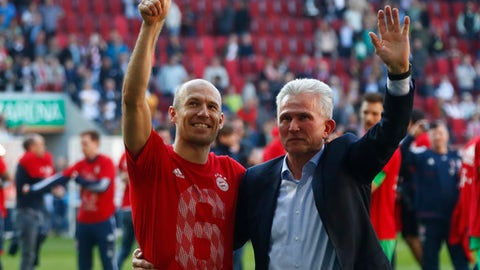 Bayern coach Jupp Heynckes, right, and Arjen Robben celebrate the 28th Bundesliga title after the German Bundesliga soccer match between FC Augsburg and FC Bayern Munich in Augsburg, Germany, Saturday, April 7, 2018. (AP Photo/Matthias Schrader)