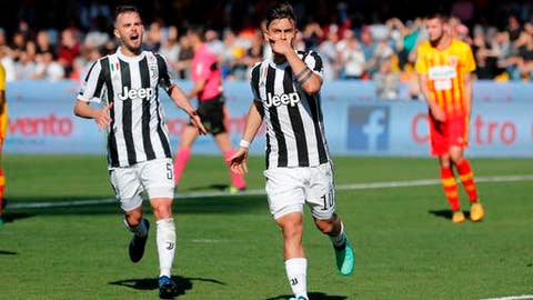 Juventus's Paulo Dybala, right, flanked by his teammate Miralem Pianic, celebrates after scoring during an Italian Serie A soccer match between Benevento and Juventus, at the Ciro Vigorito Stadium, in Benevento, Italy, Saturday, April 7, 2018. (Mario Taddeo/ANSA via AP) ITALY OUT