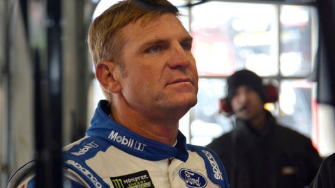 Clint Bowyer looks up at a computer display after participating in a practice session for the NASCAR Cup series auto race in Fort Worth, Texas, Saturday, April 7, 2018. (AP Photo/Randy Holt)