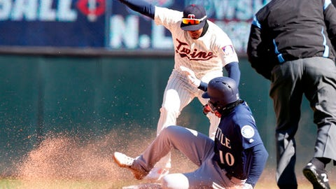 Seattle Mariners' Mike Marjama is forced out at second base by Minnesota Twins second baseman Brian Dozier on a fielder's choice in the seventh inning of a baseball game Saturday, April 7, 2018, in Minneapolis. (AP Photo/Jim Mone)