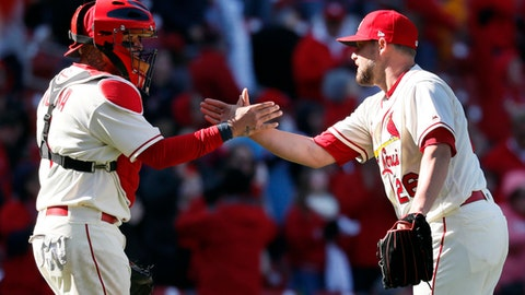 St. Louis Cardinals relief pitcher Bud Norris, right, and catcher Yadier Molina celebrate after a baseball game against the Arizona Diamondbacks, Saturday, April 7, 2018, in St. Louis. (AP Photo/Jeff Roberson)