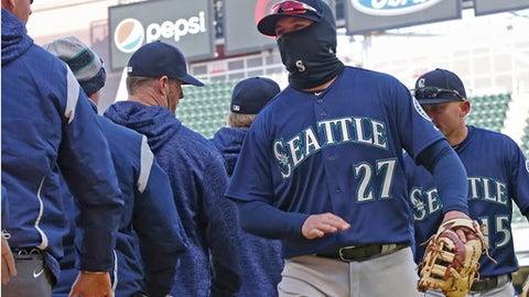 Seattle Mariners' Ryon Healy goes through the celebration line after the Mariners defeated the Minnesota Twins 11-4 in a baseball game Saturday, April 7, 2018, in Minneapolis. (AP Photo/Jim Mone)