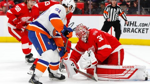 Detroit Red Wings goaltender Jared Coreau (31) stops a New York Islanders center John Tavares (91) shot in the first period of an NHL hockey game Saturday, April 7, 2018, in Detroit. (AP Photo/Paul Sancya)