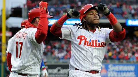 Philadelphia Phillies' Maikel Franco, right, celebrates with Rhys Hoskins after hitting a grand slam in the first inning of a baseball game against the Miami Marlins, Saturday, April 7, 2018, in Philadelphia. (AP Photo/Michael Perez)
