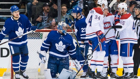 Montreal Canadiens' Daniel Carr, second from right, celebrates with teammates after scoring against the Toronto Maple Leafs during the second period of an NHL hockey game Saturday, April 7, 2018, in Toronto. (Chris Young/The Canadian Press via AP)