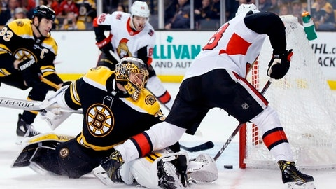 Ottawa Senators' Ryan Dzingel, right, scores on Boston Bruins' Anton Khudobin (35), of Kazakhstan, during the third period of an NHL hockey game in Boston, Saturday, April 7, 2018. The Bruins won 5-2. (AP Photo/Michael Dwyer)