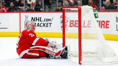 Detroit Red Wings goaltender Jared Coreau (31) sits on the ice after New York Islanders defenseman Ryan Pulock (6) scored in the third period of an NHL hockey game Saturday, April 7, 2018, in Detroit. The Islanders won 4-3 in overtime. (AP Photo/Paul Sancya)