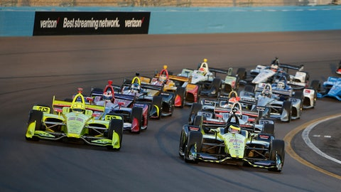 Sebastian Bourdais (18) leads the field on the first lap during the IndyCar auto race Saturday, April 7, 2018, at Phoenix International Raceway in Avondale, Ariz. (AP Photo/Rick Scuteri)