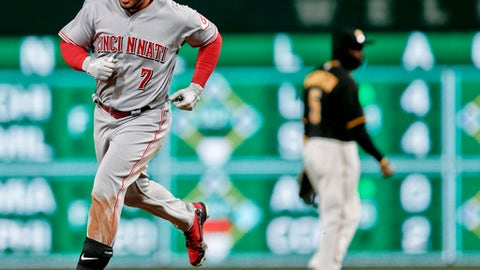 Cincinnati Reds' Eugenio Suarez rounds second behind Pittsburgh Pirates second baseman Josh Harrison after hitting a three-run-home run in the eighth inning of a baseball game, Saturday, April 7, 2018, in Pittsburgh. (AP Photo/Keith Srakocic)