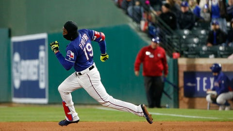 Texas Rangers' Jurickson Profar (19) runs past first base with a double against the Toronto Blue Jays during the fifth inning of a baseball game, Saturday, April 7, 2018, in Arlington, Texas. (AP Photo/Michael Ainsworth)