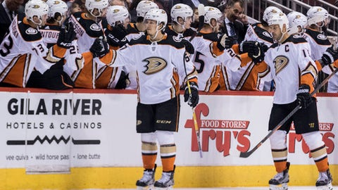 Anaheim Ducks' Rickard Rakell, front left, gets high-fives from the bench after scoring against the Phoenix Coyotes during the second period of an NHL hockey game Saturday, April 7, 2018, in Glendale, Ariz. (AP Photo/Darryl Webb