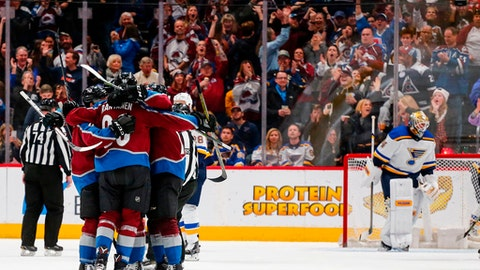 Members of the Colorado Avalanche celebrate a Tyson Barrie goal against the St. Louis Blues during the second period of an NHL hockey game Saturday, April 7, 2018, in Denver. (AP Photo/Jack Dempsey)