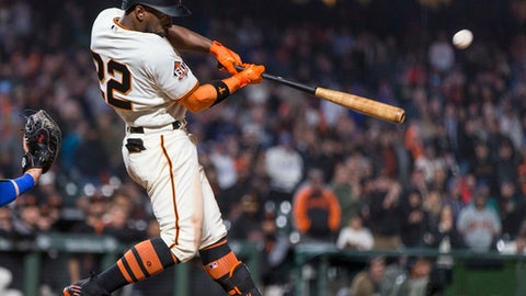 San Francisco Giants right fielder Andrew McCutchen hits a three-run home run for a walkoff win against the Los Angeles Dodgers in the 14th inning of a baseball game in San Francisco, Saturday, April 7, 2018. (AP Photo/John Hefti)