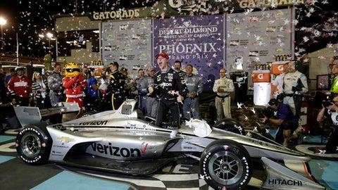 Josef Newgarden celebrates after winning an IndyCar auto race Saturday, April 7, 2018, at Phoenix International Raceway in Avondale, Ariz. (AP Photo/Rick Scuteri)