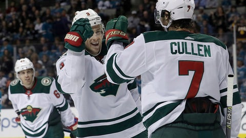 Minnesota Wild center Matt Cullen (7) is congratulated by Charlie Coyle after scoring a goal against the San Jose Sharks during the first period of an NHL hockey game in San Jose, Calif., Saturday, April 7, 2018. (AP Photo/Jeff Chiu)