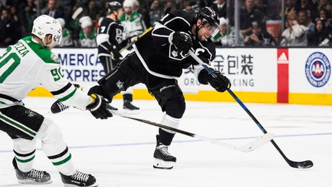 Los Angeles Kings center Anze Kopitar, right, shoots as Dallas Stars center Jason Spezza defends during the second period of an NHL hockey game Saturday, April 7, 2018, in Los Angeles. (AP Photo/Kyusung Gong)
