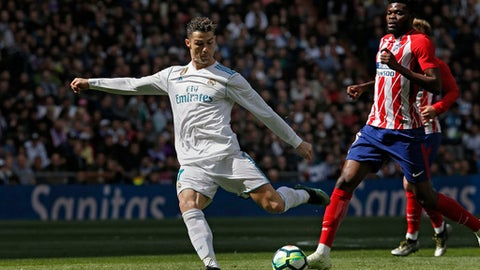 Real Madrid's Cristiano Ronaldo shoots the ball during the Spanish La Liga soccer match between Real Madrid and Atletico Madrid at the Santiago Bernabeu stadium in Madrid, Sunday, April 8, 2018. (AP Photo/Francisco Seco)