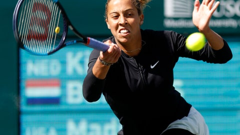 Madison Keys returns a shot to Kiki Bertens, from the Netherlands, during their semifinals match at the Volvo Car Open tennis tournament in Charleston, S.C., Sunday, April 8, 2018. (AP Photo/Mic Smith)