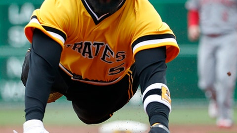 Pittsburgh Pirates' Josh Harrison advances safely to third on a sacrifice fly to right field by Starling Marte off Cincinnati Reds starting pitcher Tyler Mahle in the first inning of the team's baseball game in Pittsburgh, Sunday, April 8, 2018. (AP Photo/Gene J. Puskar)