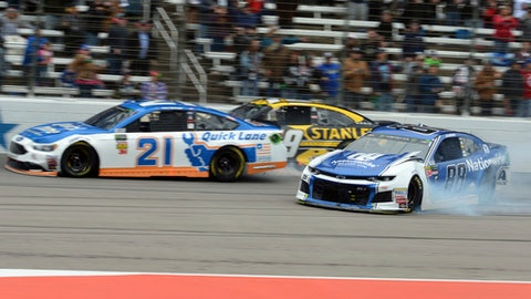 Paul Menard (21) and Chase Elliott, rear, race by as Alex Bowman (88) spins out on the front stretch early in a NASCAR Cup Series auto race in Fort Worth, Texas, Sunday, April 8, 2018. (AP Photo/Randy Holt)