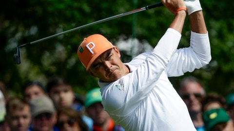 Rickie Fowler hits on the fourth hole during the fourth round at the Masters golf tournament Sunday, April 8, 2018, in Augusta, Ga. (AP Photo/Chris Carlson)