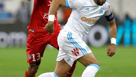 Marseille's Dimitri Payet, right, challenges for the ball with Montpellier's Ellyes Skhiri, during the League One soccer match between Marseille and Montpellier at the Velodrome stadium, in Marseille, southern France, Sunday, April 8, 2018. (AP Photo/Claude Paris)