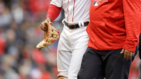 Boston Red Sox's Xander Bogaerts, left, is assisted as he leaves the field in the seventh inning of a baseball game against the Tampa Bay Rays, Sunday, April 8, 2018, in Boston. (AP Photo/Steven Senne)