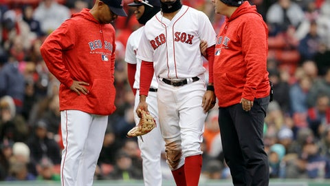 Boston Red Sox's Xander Bogaerts, center, is assisted as he leaves the field as manager Alex Cora, left, looks on in the seventh inning of a baseball game against the Tampa Bay Rays, Sunday, April 8, 2018, in Boston. (AP Photo/Steven Senne)