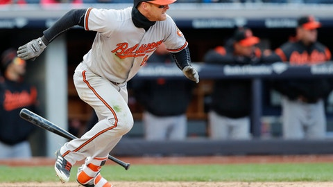 Baltimore Orioles' Craig Gentry hits an RBI single in the 12th inning of a baseball game against the New York Yankees in New York, Sunday, April 8, 2018. (AP Photo/Kathy Willens)