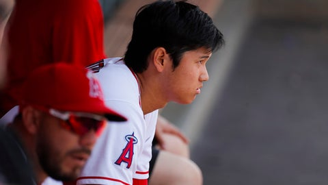Los Angeles Angels starting pitcher Shohei Ohtani, of Japan, watches from the dugout during the first inning of a baseball game against the Oakland Athletics, Sunday, April 8, 2018, in Anaheim, Calif. (AP Photo/Jae C. Hong)