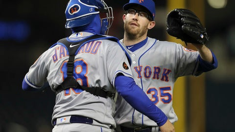 New York Mets relief pitcher Jacob Rhame (35) celebrates the final out with teammate Travis d'Arnaud (18) at the end of a baseball game against the Washington Nationals Monday, April 9, 2018 in Washington. New York won 6-5. (AP Photo/Pablo Martinez Monsivais)