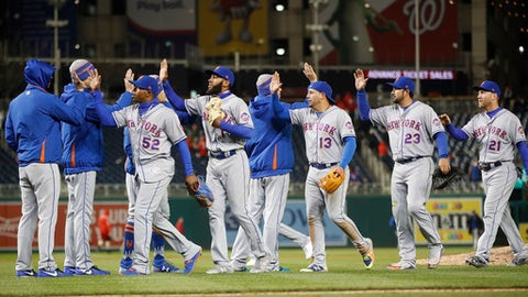 New York Mets celebrate on the field after the final out of a baseball game against the Washington Nationals, Monday, April 9, 2018 at Nationals Park in Washington. New York won 6-5. (AP Photo/Pablo Martinez Monsivais)