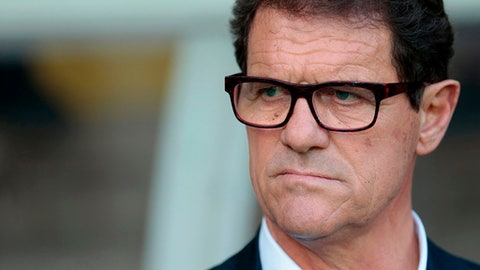 FILE - In this June 14, 2015 file photo, then Russia's coach Fabio Capello watches his players during the Euro 2016 qualifying soccer match between Russia and Austria, in Moscow, Russia. Capello, former AC Milan, Real Madrid, Roma and Juventus coach has announced Monday April 9, 2018  his retirement from coaching and that he's not interested in the open job with Italy's national team. (AP Photo/Ivan Sekretarev, File)