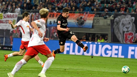 Leverkusen's Kai Havertz, right, scores a goal during the German first division Bundesliga soccer match between RB Leipzig and Bayer Leverkusen in Leipzig, Germany, Monday, April 9, 2018. (AP Photo/Jens Meyer)