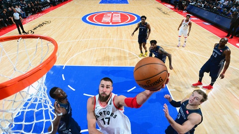 DETROIT, MI - APRIL 9:  Jonas Valanciunas #17 of the Toronto Raptors goes to the basket against the Detroit Pistons on April 9, 2018 at Little Caesars Arena, Michigan. (Photo by Chris Schwegler/NBAE via Getty Images)