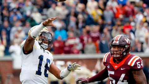 FILE - In this Nov. 11, 2017, file photo, Georgia Tech quarterback TaQuon Marshall, left, throws an interception against the defense of Virginia Tech's Andrew Motuapuaka (54) in the fourth quarter of an NCAA college football game in Atlanta. Marshall's 2017 season included some of the best running _ and worst passing _ for a player at his position in school history.. (AP Photo/David Goldman, File)