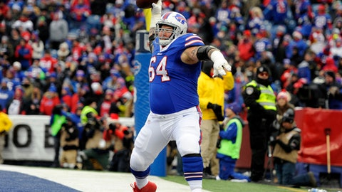 Buffalo Bills guard Richie Incognito (64) spikes the ball after a touchdown by running back LeSean McCoy during the first half of an NFL football game against the Miami Dolphins, Sunday, Dec. 17, 2017, in Orchard Park, N.Y. Buffalo beat Miami 24-16. (AP Photo/Adrian Kraus)