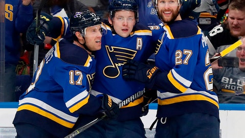 FILE - In this April 4, 2018, file photo, St. Louis Blues' Vladimir Tarasenko, of Russia, is congratulated by teammates Jaden Schwartz (17) and Alex Pietrangelo (27) after scoring during the second period of an NHL hockey game against the Chicago Blackhawks, in St. Louis. After a season-ending loss put an end to their season without a playoff appearance, the St. Louis Blues and coach Mike Yeo are left looking to the future. Its an offseason that includes the next 4-6 months without standout winger Vladimir Tarasenko, who will have surgery this week for a separated left shoulder. (AP Photo/Jeff Roberson, File)