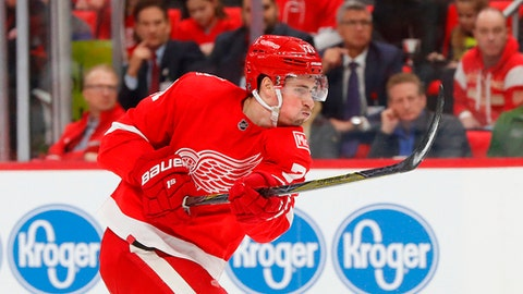 FILE - In this Jan. 31, 2018, file photo, Detroit Red Wings center Dylan Larkin (71) shoots against the San Jose Sharks in the second period of an NHL hockey game, in Detroit. Technology is available to track how fast players are skating, how hard they're shooting and how quickly they're getting the puck from end to end. Larkin would be in favor of fans seeing how fast players are skating and how hard their shooting the puck, saying it would give them a better viewing experience on TV and in arenas. (AP Photo/Paul Sancya, File)