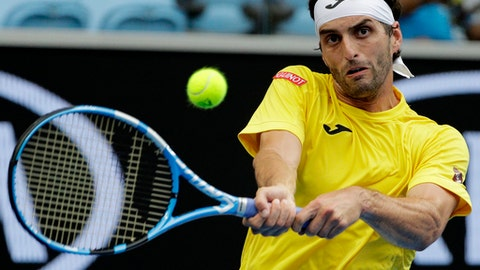 Spain's Albert Ramos-Vinolas makes a backhand return to Serbia's Novak Djokovic during their third round match at the Australian Open tennis championships in Melbourne, Australia, Saturday, Jan. 20, 2018. (AP Photo/Dita Alangkara)