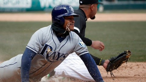 Chicago White Sox first baseman Jose Abreu, right, tags first base as Tampa Bay Rays Mallex Smith, left, tries to slide in during the fifth inning of a baseball game in Chicago, Tuesday, April 10, 2018. (AP Photo/Jeff Haynes)